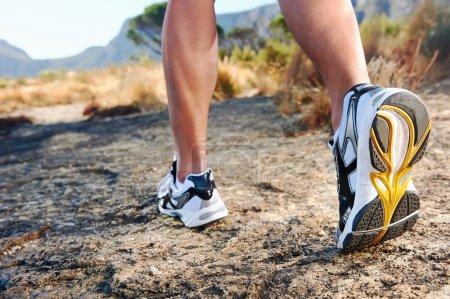 man feet running
