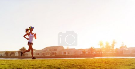 Photo for Athlete running at sunset panorama with copyspace - Royalty Free Image