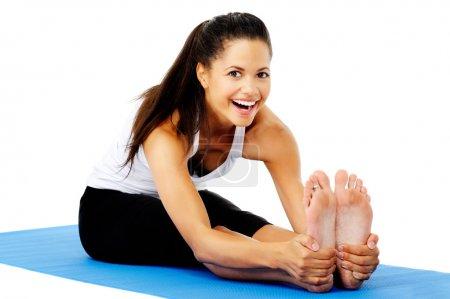 Happy stretching yoga woman