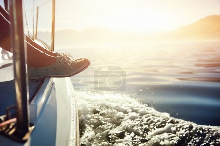 Photo for Feet on boat sailing at sunrise lifestyle - Royalty Free Image