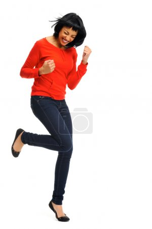 Excited woman jumps in joy