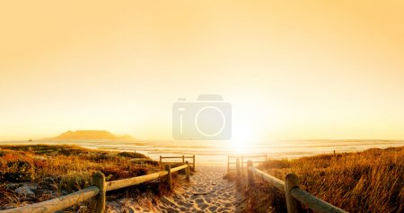 Photo for Sunset panorama HDR of a beach near cape town, south africa. Table mountain can be seen in the distance. Very large file perfect for backgrounds or billboards - Royalty Free Image