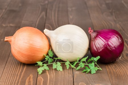 Photo for Yellow, withe and red onion on a wooden background - Royalty Free Image