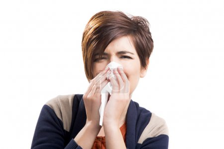 Photo for Portrait of a woman with flu, isolated over a white background - Royalty Free Image
