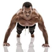 Muscle man making pushups