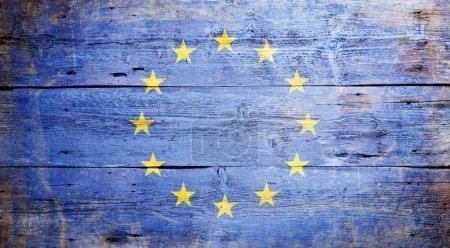 Photo for Flag of Europe painted on grungy wood plank background - Royalty Free Image