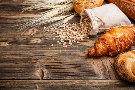 Photo for Fresh croissant on old wooden table - Royalty Free Image
