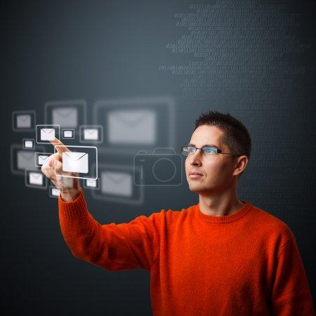 Man pressing mail symbol