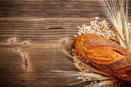 Photo for Top view on loaf bread and dry ear - Royalty Free Image
