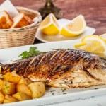 Close up of sea bream fish with potato...