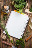 Open notebook with herbs