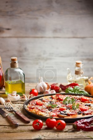 Photo for Delicious italian pizza served on old wooden table - Royalty Free Image