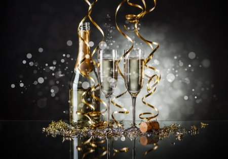 Photo for Glasses of champagne and bottle with festive background - Royalty Free Image