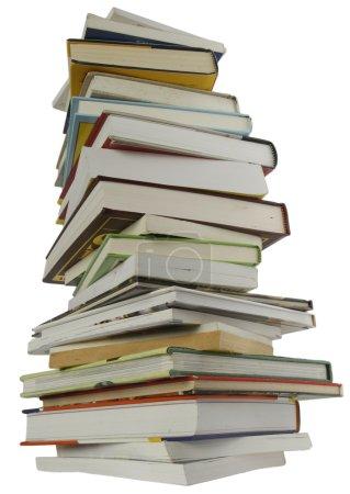Photo pour Livres hautes pile isolé sur fond blanc - image libre de droit
