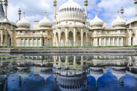 Photo for Onion domes, towers and minarets forming the roof of the royal pavilion palace in brighton england, King George IV's summer house and Regency folly - Royalty Free Image