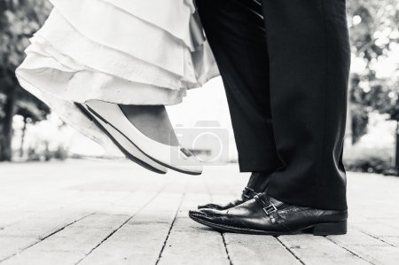 Wedding shoes in a standing and flying of couple