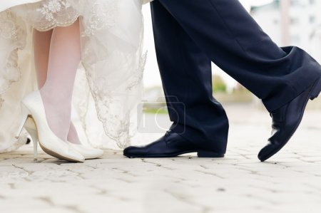 Wedding shoes in a standing bride and groom