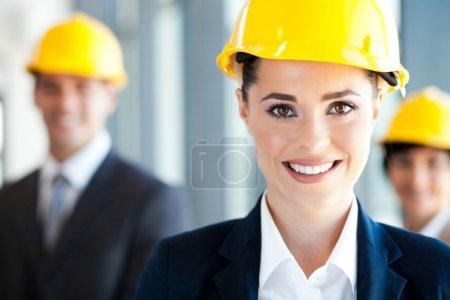Pretty and smart construction businesswoman closeup