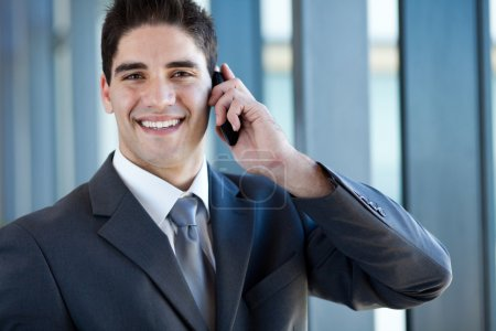 Photo for Happy successful young business man talking on cell phone - Royalty Free Image