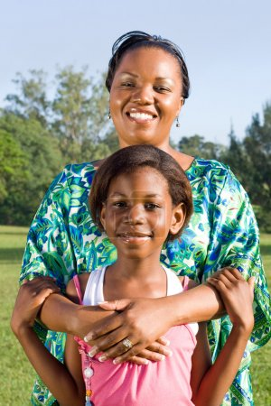 Happy african american mother and daughter portrait outdoors