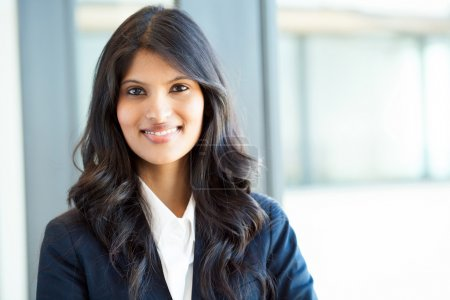 Photo for Beautiful young indian businesswoman portrait in office - Royalty Free Image