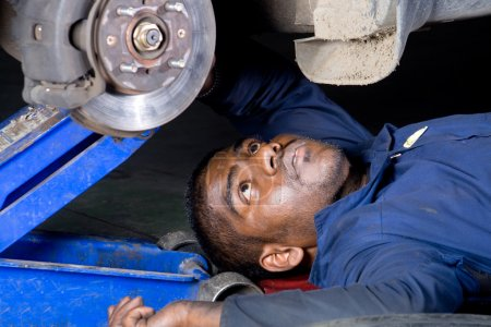 Mechanic doing repair work on a vehicle