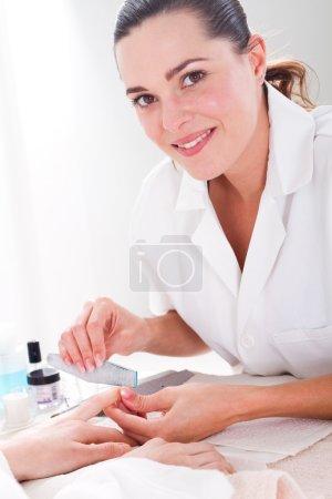 Beautiful professional manicurist at work