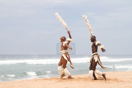 Photo for Two african zulu men dancing on beach - Royalty Free Image