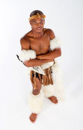 Overhead view of african tribal man in studio...
