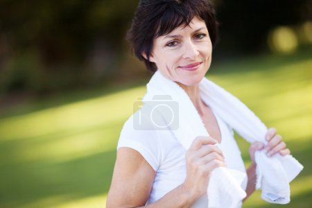 Elegant middle aged woman relaxing after workout