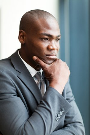 Thoughtful african american businessman in office