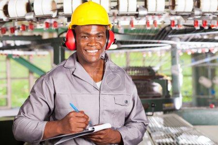 Handsome african american blue collar worker portrait inside factory