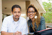 Two african american college students studying together