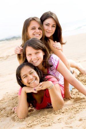 Group of teen girls having fun on beach