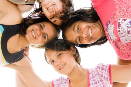 Group of teen girls looking down at camera