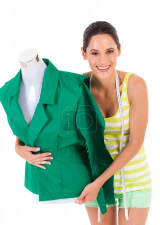 Happy young dressmaker holding mannequin on white