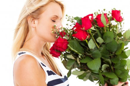 Photo for Pretty young woman smelling bunch of roses - Royalty Free Image
