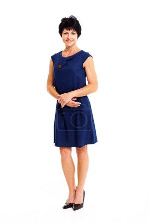 Foto de Mujer edad media elegante en retrato de cuerpo entero vestido azul aislado en blanco - Imagen libre de derechos