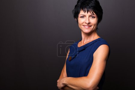 Cute middle aged woman portrait on black...