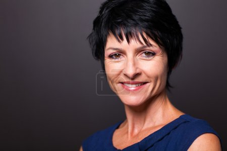Pretty middle aged woman closeup portrait on black