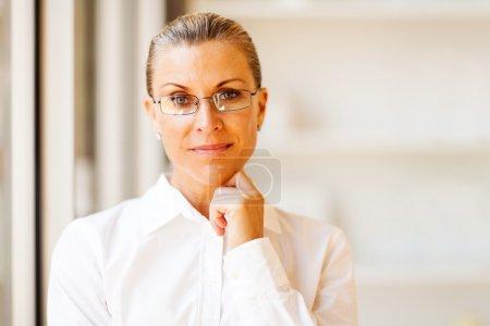 Determined senior businesswoman portrait in office