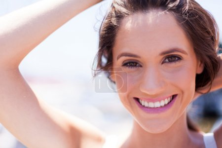 Closeup of cute young woman laughing