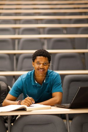african american college boy in lecture room