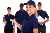 Pretty female technical service worker presenting team on white
