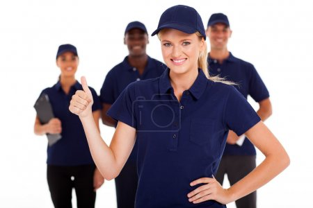 Technical service woman thumb up with team in background