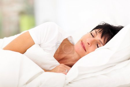 Photo for Cute mature woman sleeping on bed - Royalty Free Image