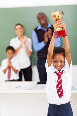 Schoolgirl holding a trophy