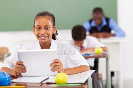 schoolgirl using a tablet computer