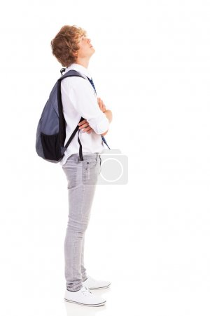 Photo for Teen boy with backpack looking up - Royalty Free Image