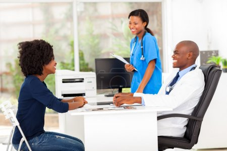 african female patient visiting doctor